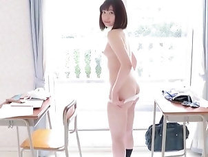 Japanese schoolgirl Satomi shows her white panties in class